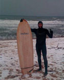 JJ with Soultree board on the beach